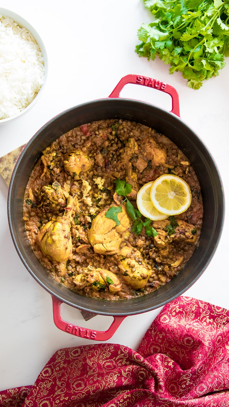 pot of chicken dhansak curry with rice and cilantro around next to it - for Ramadan 2021