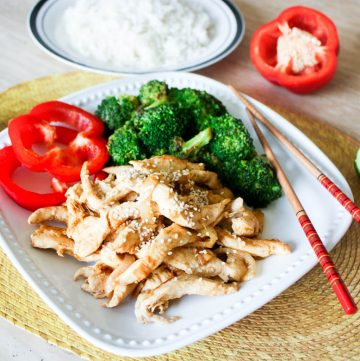 Ginger lime chicken with broccoli on a white plate