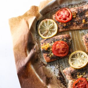 baked salmon in sheet pan with tomatoes and lemon slices