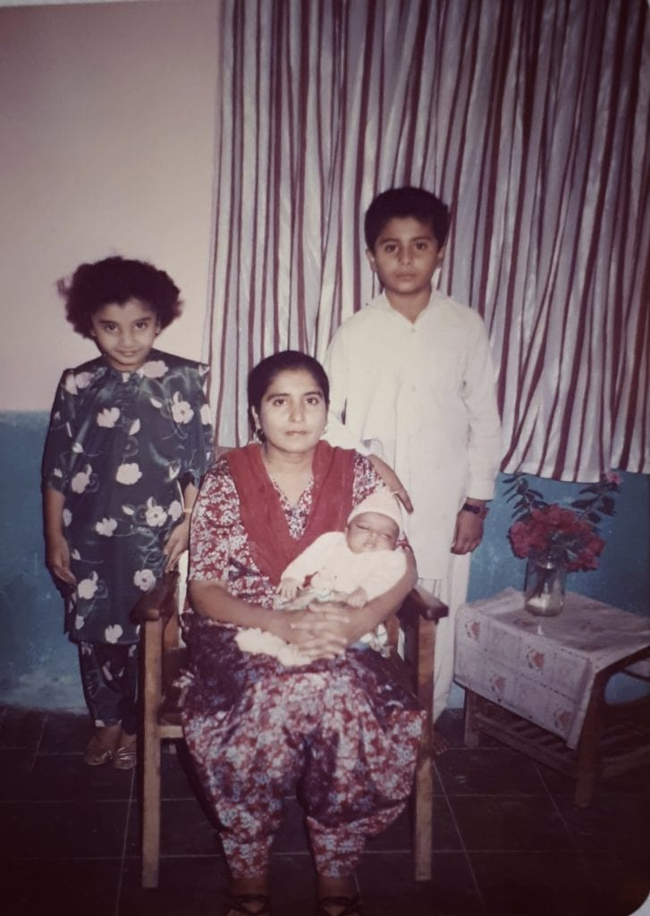Family portrait of Shahzadi Devje's family in Pakistan with her mum, brother and newly born sister.