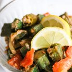 bowl of spicy okra with onions and tomatoes
