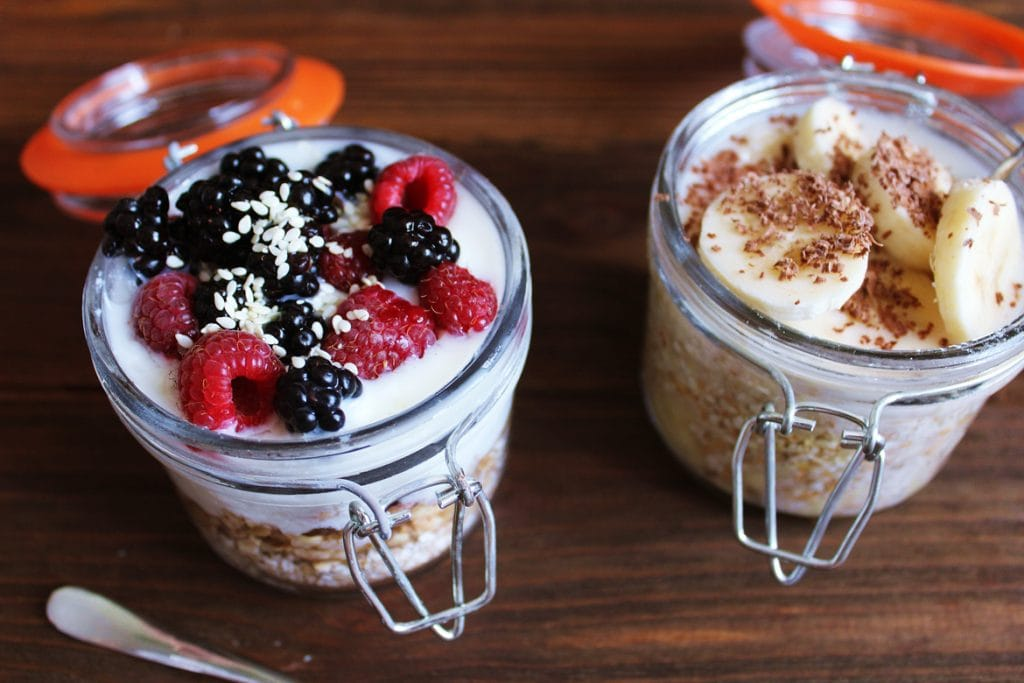 mason jars with yoghurt, fruit and cereal