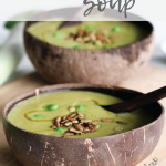 two bowls of mint and pea soup with sprinkle of seeds