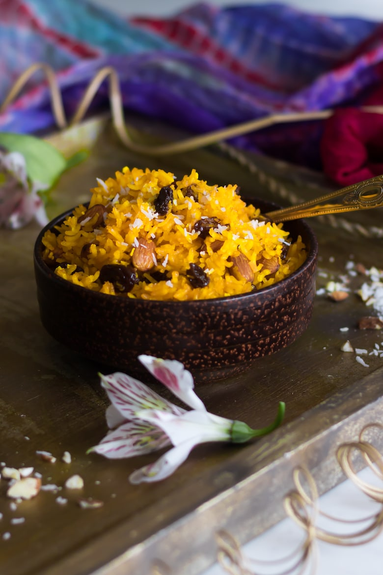bowl of zarda (sweet rice) on a gold tray