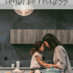 a woman and little girl in the kitchen joining foreheads