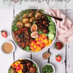 Easy and healthy recipe of colorful bowl of soy maple glazed salmon fillet served with potatoes, mushrooms, mango and strawberry salad on a bed of lettuce