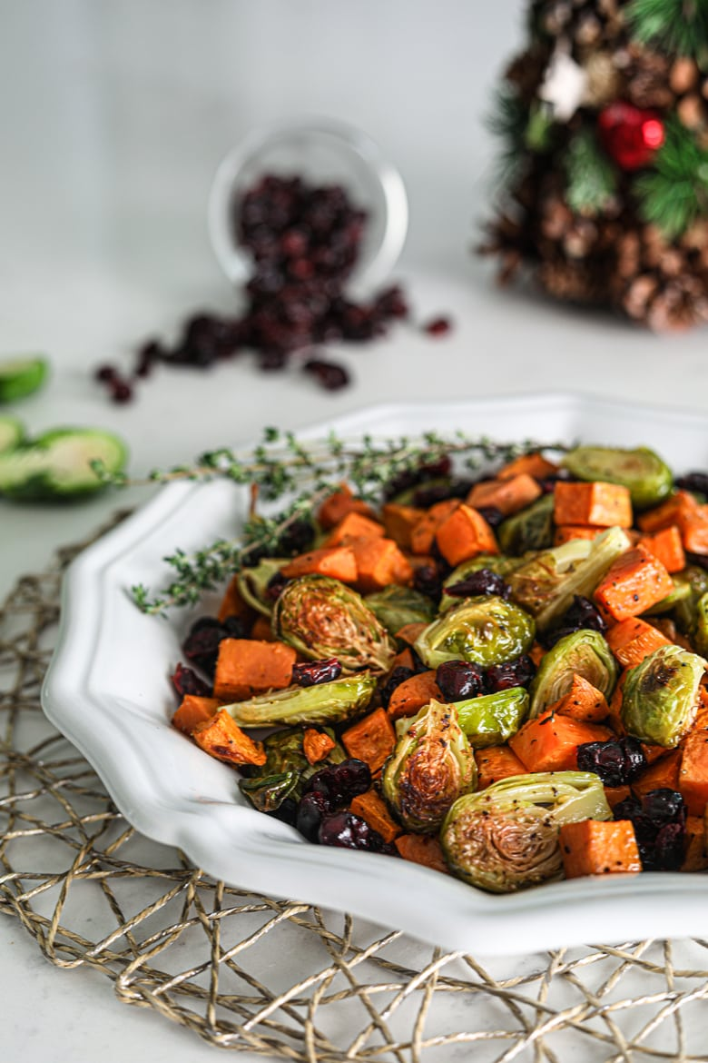 Plate of easy and healthy roasted Brussel sprouts recipe with sweet potatoes and cranberries