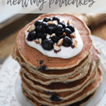 a stack of easy and healthy pancakes in a tray topped with yogurt and blueberries