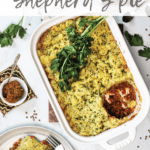vegan Shepherd's pie in a white baking dish topped with fresh parsley with a portion served in a plate