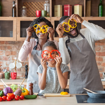 Kitchen Fun. Sweet African Family Having Fun While Cooking, wearing pepper glasses, copy space