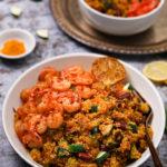 Bowl of vegetable quinoa with garlic shrimp recipe side angle