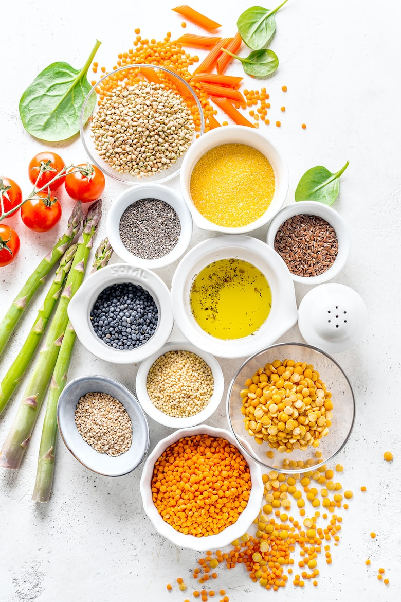 Healthy food concept. Food background with healthy ingredients and vegetables. Cooking concept. Different grains, beans on white background.