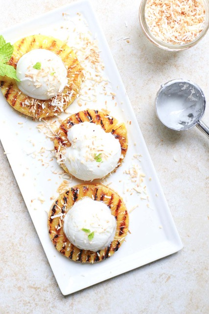 BBQ pineapple rounds topped with ice cream flatlay