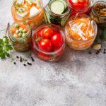 Fermented food. Preserved season vegetables in jars. Selective focus