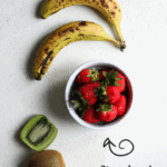 flat lay of fresh fruits: bananas, kiwi and a bowl of strawberries