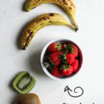 flat lay of fresh fruits: bananas, kiwi and a bowl of strawberries