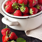 Sweet fresh strawberry in a white bowl.