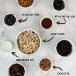flat-lay of ingredients - with labels - for blueberry vegan cheesecake