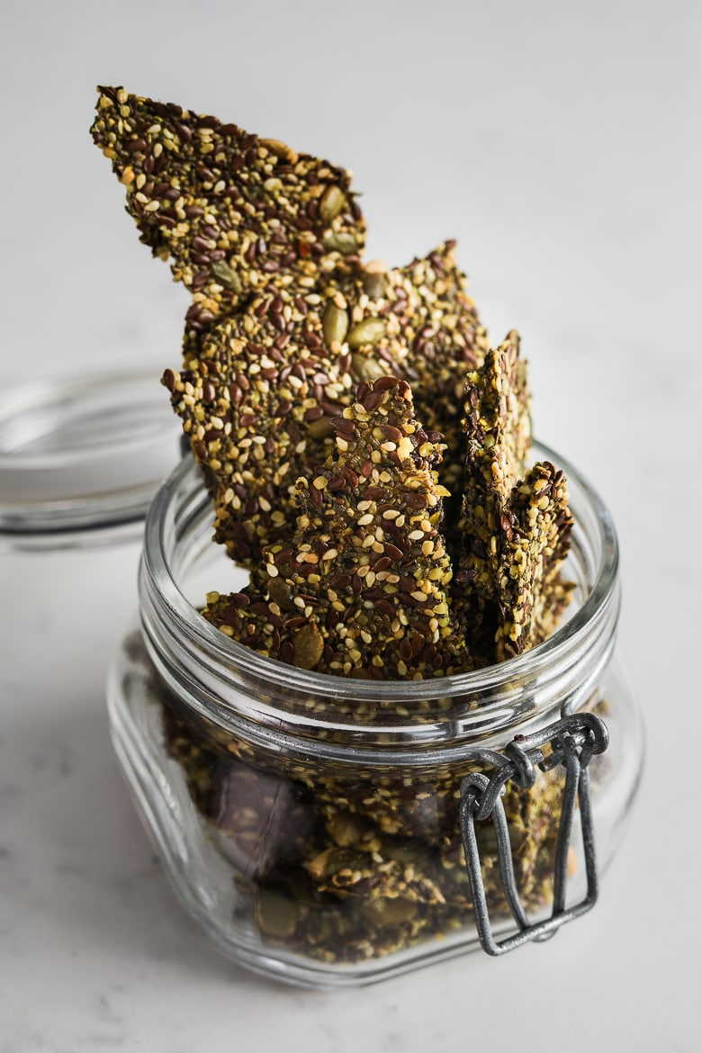 jar overflowing with homemade seeded crackers