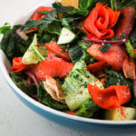 close up shot of bowl of fattoush salad with smoked salmon