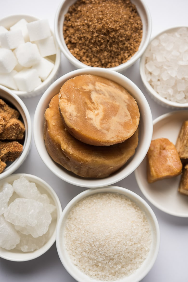 an array of added sugars in small bowls