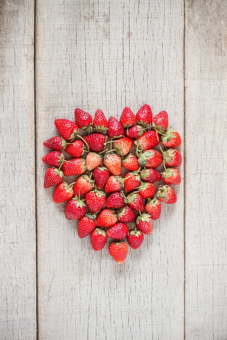 Strawberries ripe of heart on old wood.