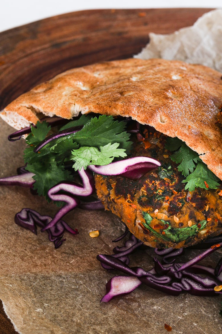 pita stuffed with vegan kebab, purple cabbage and cilantro leaves