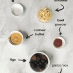 ingredients with accompanying labels for making dried fruit and nut laddu.