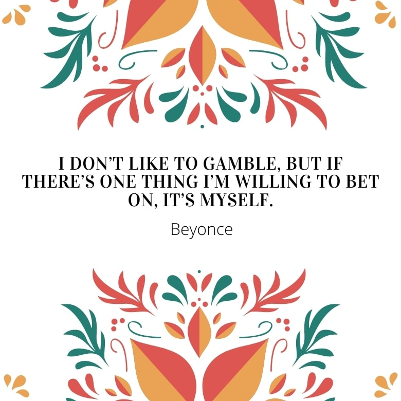 white graphic with red, green and orange ethnic design stems and leaves overlaid with a self love quote by Beyonce