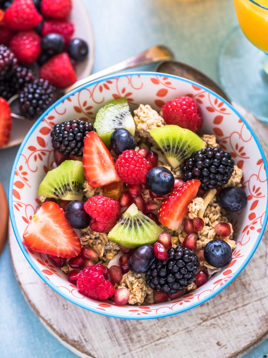 fresh fruits in breakfast bowl and honey as a natural way to fall asleep