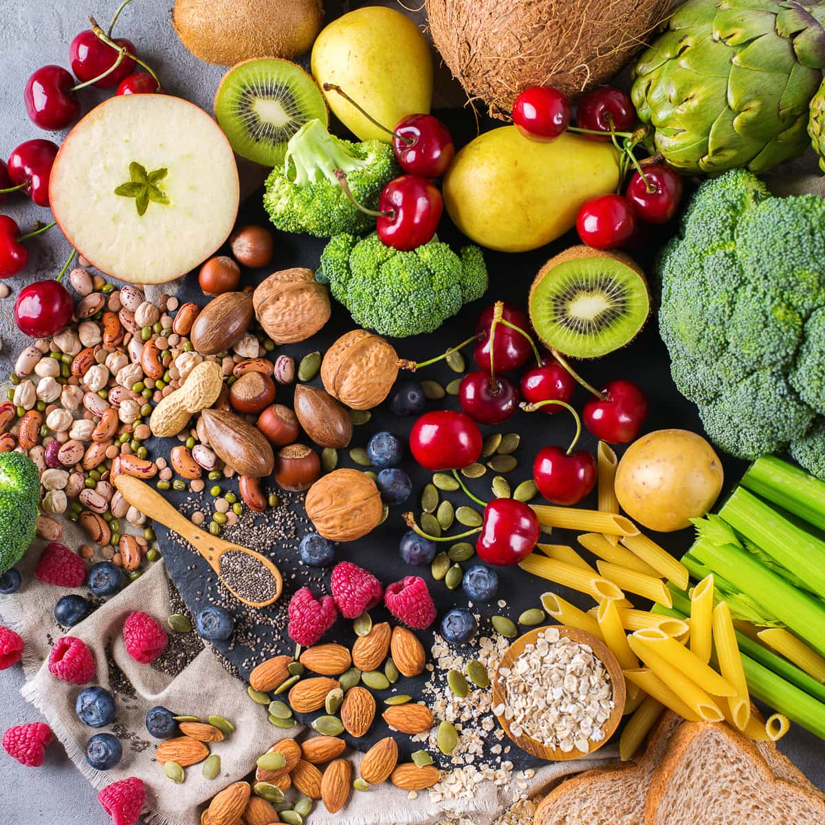 Healthy balanced dieting concept. Selection of rich fiber sources vegan food. Vegetables fruit seeds beans ingredients for cooking. Top view flat lay